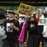 Black Lives Matter Tokyo organizers lead protesters on a march through Shibuya Ward on Sunday. | RYUSEI TAKAHASHI