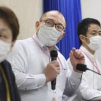 Experts worried by Japan's moves to ease coronavirus entry restrictions