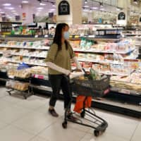 After being hit hard by the new coronavirus outbreak, consumer spending in Japan started picking up sharply in the second half of May, according to a private-sector survey. | REUTERS