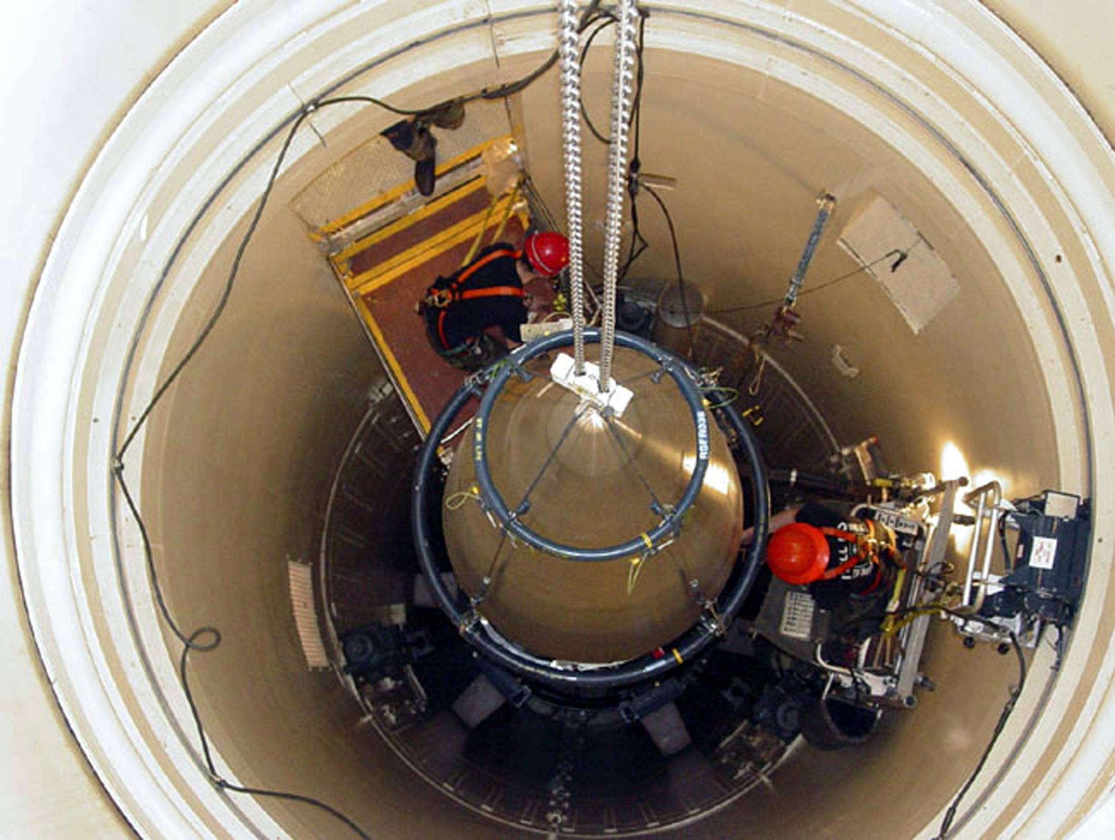 A U.S. Air Force missile maintenance team removes the upper section of an intercontinental ballistic missile with a nuclear warhead at Malmstrom Air Force Base in Montana.  | USAF / VIA REUTERS