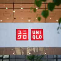 Fast Retailing Co., operator of the Uniqlo clothing stores, will begin selling reusable face masks in Japan this week for ¥990 for a set of three.  | BLOOMBERG