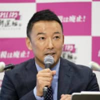 Taro Yamamoto, head of Reiwa Shinsengumi, announces his candidacy for the Tokyo gubernatorial election at the Diet building in the capital on Monday. | KYODO