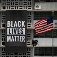 A Black Lives Matter banner at the U.S. Embassy in Seoul was removed on Monday.  | REUTERS