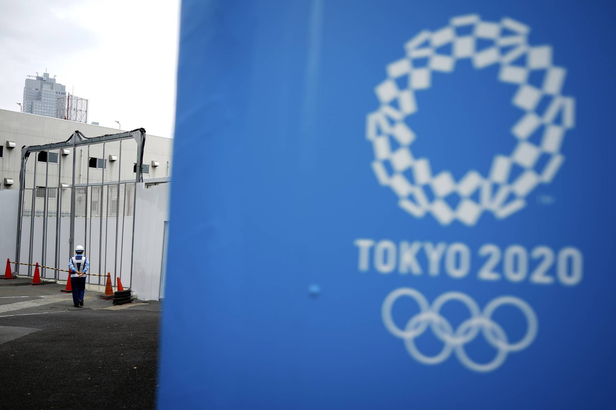 A security guard stands at one of the venues for the Tokyo Olympics on May 12. | AP