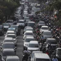 Jakarta partly reopened in early June after two months of partial lockdown, resulting in the return of crowded streets filled with rush hour traffic. | AP