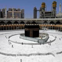 Muslim worshippers walk around the sacred Kaaba in Mecca's Grand Mosque, Islam's holiest site, during the coronavirus COVID-19 pandemic, on April 3. | AFP-JIJI