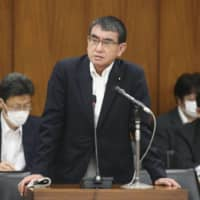 Defense Minister Taro Kono speaks at a Lower House committee meeting Tuesday. | KYODO