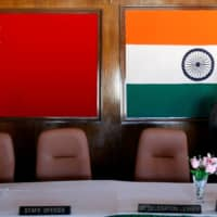 A man walks inside a conference room used for meetings between military commanders of China and India, at the Indian side of the Indo-China border in Bumla, in the northeastern Indian state of Arunachal Pradesh, in November 2009. China on Tuesday accused India of crossing a disputed border between the two countries, as the Indian Army said three of its soldiers had been killed in violent clashes. | REUTERS