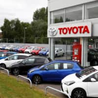Cars are seen outside the Toyota car showroom in Stockport, Britain, on May 26. | REUTERS