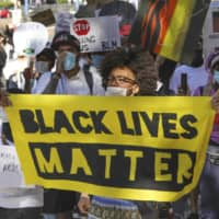 Participants in a Back Lives Matter protest call for eradicating racial discrimination in the city of Osaka on June 7. | KYODO