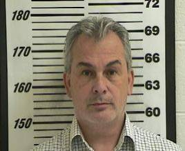 Michael Taylor, who was implicated in enabling the dramatic escape of former Nissan Motor Co. boss Carlos Ghosn, is seen in a booking photograph from October 24, 2012, when he was detained on unrelated charges. | DAVIS COUNTY SHERRIFF'S OFFICE / VIA REUTERS