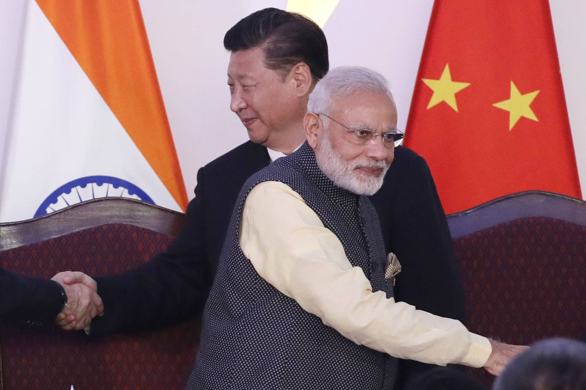 In this Oct. 16, 2016, file photo, Indian Prime Minister Narendra Modi and Chinese President Xi Jinping greet other leaders during a summit in Goa, India, in 2016.  | AP