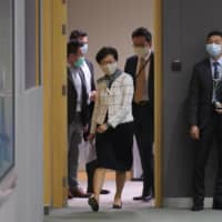 Hong Kong Chief Executive Carrie Lam arrives for a news conference in Hong Kong on Tuesday.  | AP