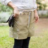 Workwear flair: Sanpu Sanyo's Sanpu Maekake work aprons are made from durable sailcloth and accent panels with traditional designs.