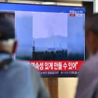 People watch a news report in Seoul on Tuesday about the explosion of the inter-Korean liaison office in North Korea's Kaesong Industrial Complex. | AFP-JIJI