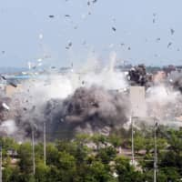 North Korea on Tuesday destroyed the joint liaison office with South Korea in the border town Kaesong. | KCNA / VIA REUTERS