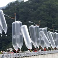 South Korean activists launch balloons carrying leaflets denouncing North Korea's leader during a rally in Hwacheon, South Korea, in July 2010.  | AP