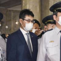 Katsuyuki Kawai leaves the Diet after the Lower House plenary session Wednesday. | KYODO