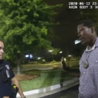A screen grab taken from the body camera video provided by the Atlanta Police Department shows Rayshard Brooks speaking with officer Garrett Rolfe on Friday, the night Brooks was fatally shot.  | ATLANTA POLICE DEPARTMENT / VIA AP