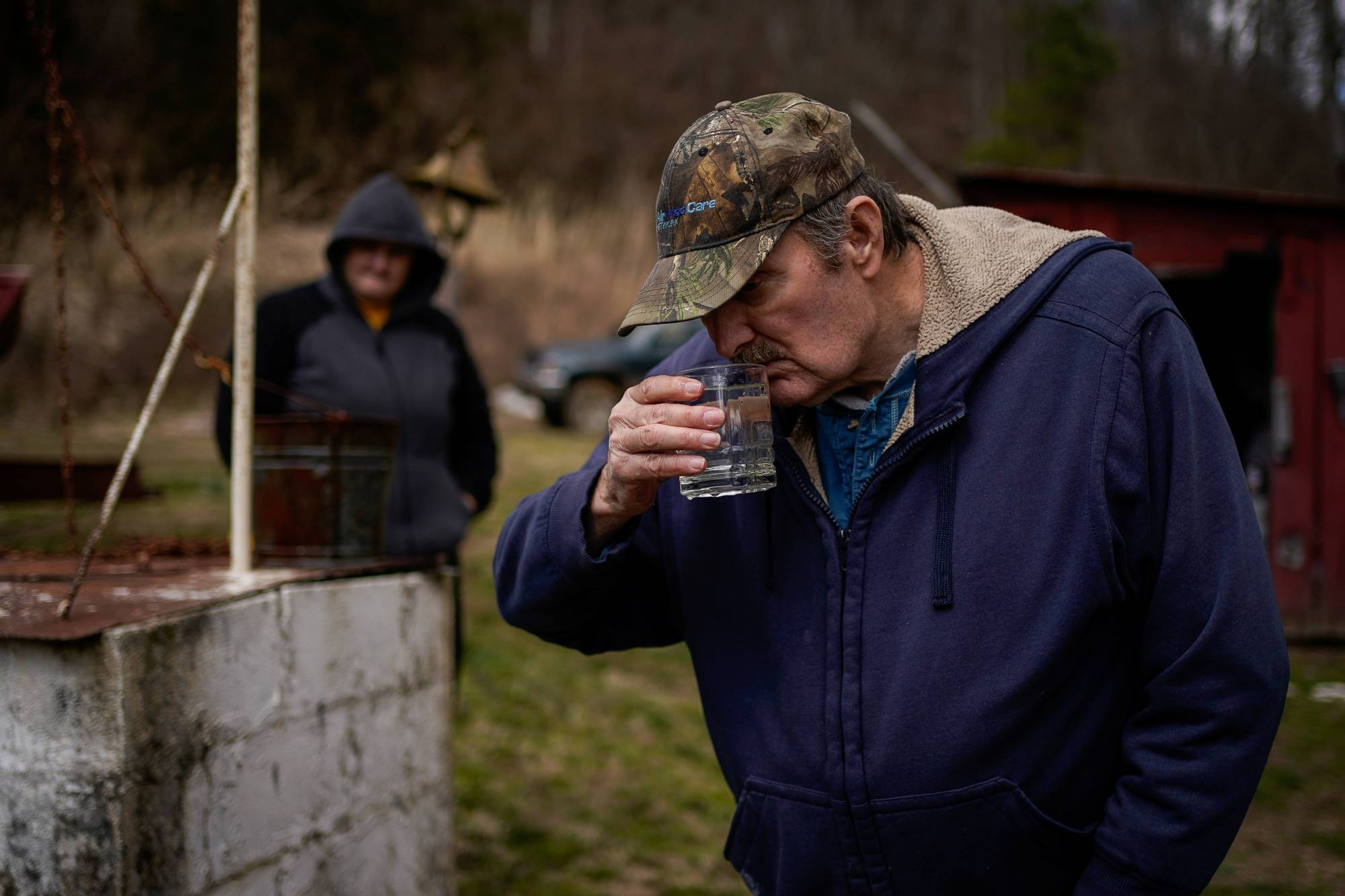 Hanson Rowe, a landowner who blames a leaky gas well on his property for health problems, smells water drawn from a contaminated well on his property in Salyersville, Kentucky, in February.  | REUTERS