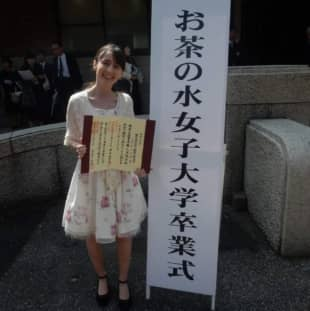 Annamaria poses in front of Tokyo's Ochanomizu University after completing her undergraduate program. Travel restrictions have left Annamaria, a graduate student who traveled to Slovakia in March to visit her family, unable to return to continue her research. | COURTESY OF ANNAMARIA