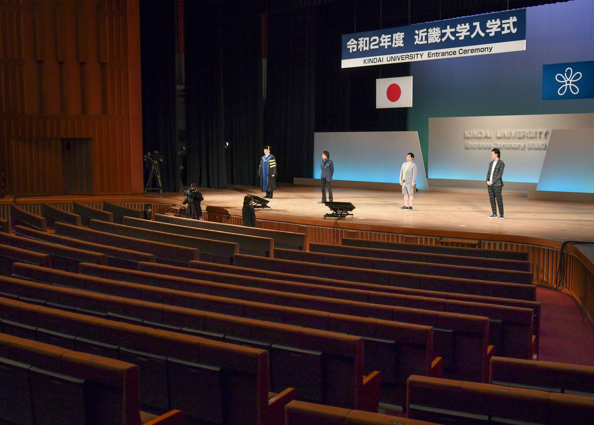 An entrance ceremony for Kindai University is held in Osaka on April 4 with no students present due to the spread of the new coronavirus. The students watched via YouTube. | KYODO