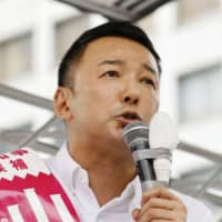 Taro Yamamoto, a candidate in the Tokyo gubernatorial election, appeals to voters in Tokyo's Shinjuku Ward on Thursday. | KYODO