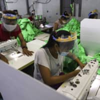 Garment factories have been closed across Southeast Asia as demand plummets amid the coronavirus pandemic. About a third of the 600 garment factories in Cambodia are shut, which has cost tens of thousands of workers their jobs and left them struggling to survive as state aid has been slow to materialize. | AP