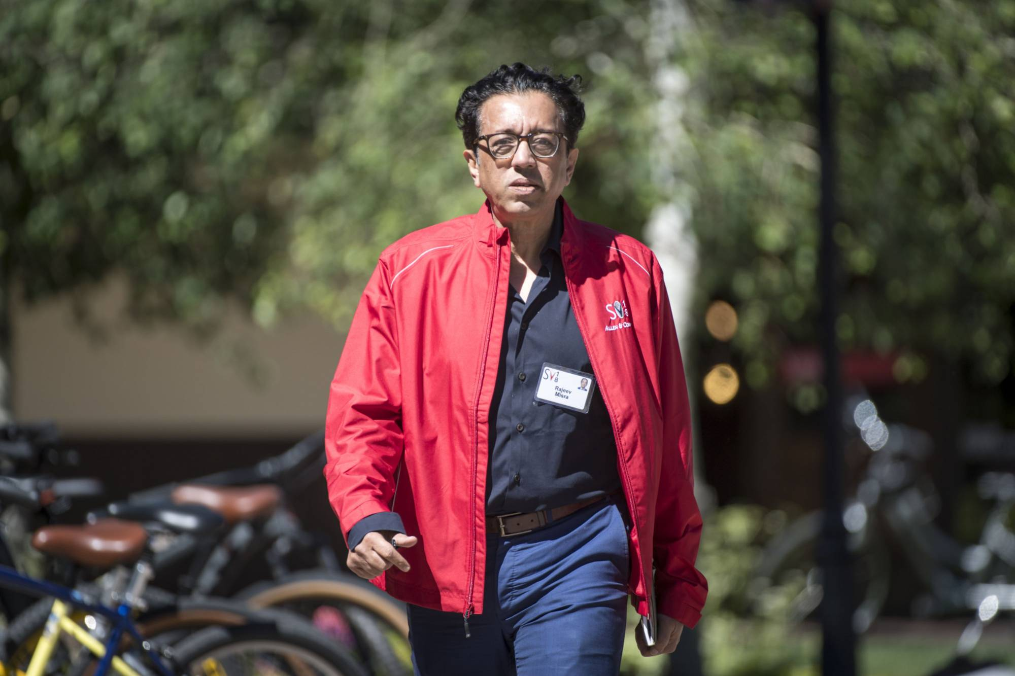 Rajeev Misra, chief executive officer of investment advisors for SoftBank Corp., walks in Sun Valley, Idaho, in July 2018. | BLOOMBERG