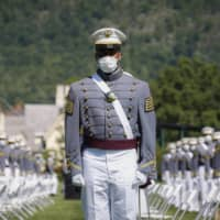 United States Military Academy graduating cadets wear face masks during commencement ceremonies last week. More U.S. states are mandating that people wear masks in public to curb the spread of the virus.  | POOL / VIA AP