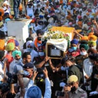 Family members and villagers carry the coffin of a soldier who was was killed in a recent clash with Chinese forces in the Galwan valley area, during the cremation ceremony at Bhojraj village near Gurdaspur on Thursday.  | AFP-JIJI