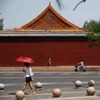 China's handling of the virus is again in the spotlight after more than 180 new infections were reported in Beijing over the last week or so, the most in the city since February. | REUTERS