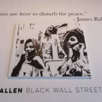 A gallery featuring black artists displays art during Juneteenth celebrations in the Greenwood district of Tulsa, the site of the 1921 race massacre, on Friday.   AFP-JIJI