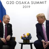 U.S. President Donald Trump speaks with Russian leader Vladimir Putin during a bilateral meeting on the sidelines of the Group of 20 summit in Osaka last June. The U.S. and Russia have agreed to start arms control talks this month as the only remaining treaty between the two largest nuclear powers is poised to expire in less than a year. | AP