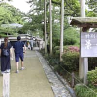 People visit Kenrokuen, one of Japan's three most famous gardens, in Kanazawa, Ishikawa Prefecture, on Saturday, a day after the government lifted its last-remaining advisories recommending against inter-prefecture travel amid the coronavirus pandemic. | KYODO