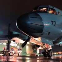 A Maritime Self-Defense Force P-3C Orion anti-submarine and maritime surveillance aircraft carries a Harpoon anti-ship missile as part of Rim of the Pacific (RIMPAC) exercise in Hawaii and California in 2014.  | MARITIME SELF-DEFENSE FORCE