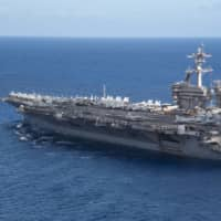 The aircraft carrier USS Theodore Roosevelt operates in the Philippine Sea on May 21, following an extended visit to Guam in the midst of the coronavirus pandemic. | U.S. NAVY