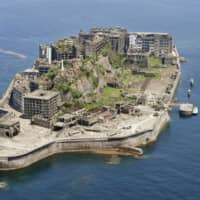 The Hashima Coal Mine in Nagasaki Prefecture, known as 'Battleship Island' because of its shape, is one of the 23 sites spanning eight prefectures that were added to the World Cultural Heritage list in 2015 under 'Sites of Japan's Meiji Industrial Revolution: Iron and Steel, Shipbuilding and Coal Mining.' | KYODO