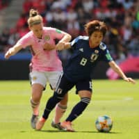 Japan's Mana Iwabuchi (right) and Scotland's Kim Little vie for the ball during their match at the Women's World Cup on June 14, 2019, in Rennes, France. | REUTERS
