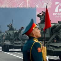 A rehearsal for the Victory Day parade takes place in St. Petersburg on Saturday. Russian President Vladimir Putin will preside the parade on Wednesday to mark the Soviet victory in World War II, which was postponed due to the pandemic.  | AFP-JIJI