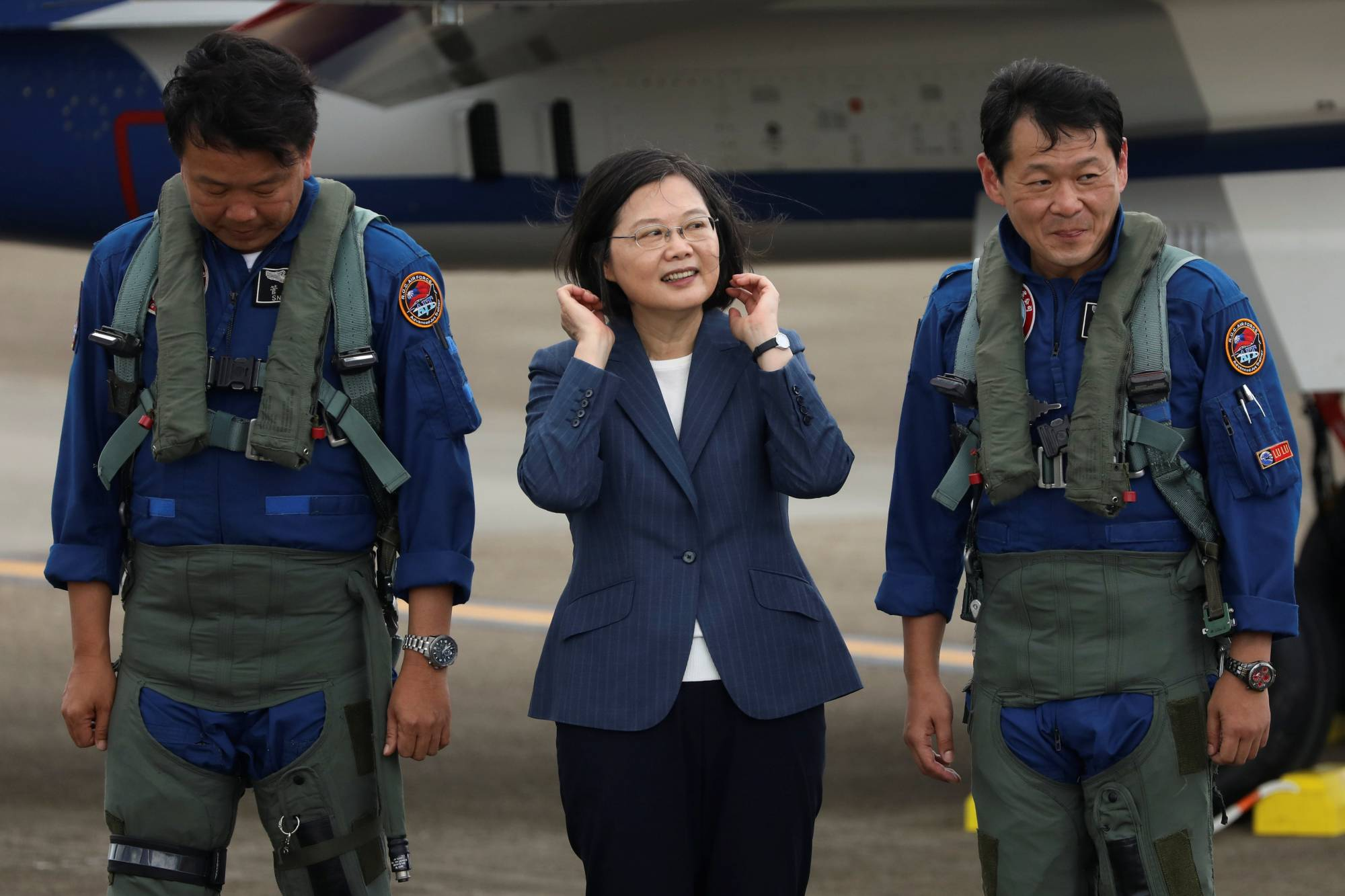 Taiwanese President Tsai Ing-Wen prepares to take photos with the pilots of an AIDC T-5 Brave Eagle, Taiwan's first locally manufactured advanced jet trainer, in Taichung on Monday.  | REUTERS
