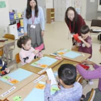 Children of foreign nationalities learn Japanese in Kani, Gifu Prefecture, in February. | KYODO