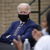 Democratic presidential candidate, former Vice President Joe Biden, listens during a meeting with small business owners in Yeadon, Pennsylvania, on Wednesday. | AP