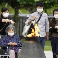 People visit the Peace Memorial Park in Itoman, Okinawa Prefecture, on Tuesday as the nation marked the 75th anniversary of the end of the Battle of Okinawa. | KYODO