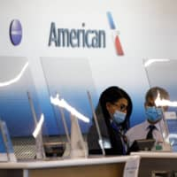 American Airlines is selling $750 million of shares and the same amount of senior convertible notes due in 2025, the carrier said in a statement Sunday. | BLOOMBERG