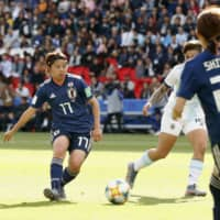 Japan's Narumi Miura (left) passes the ball during a Women's World Cup match against Argentina on July 9, 2019, in Paris. | KYODO