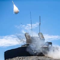 This undated photo released by Taiwan's Defense Ministry shows a projectile being launched from a U.S.-made Avenger surface-to-air missile system during exercises in Pingtung country, southern Taiwan. |  TAIWAN DEFENSE MINISTRY / VIA AFP-JIJI