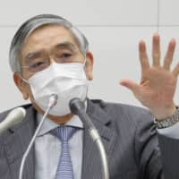 Bank of Japan Gov. Haruhiko Kuroda speaks during a news conference at the central bank's headquarters in Tokyo on June 16. | BLOOMBERG