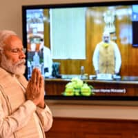 Indian Prime Minister Narendra Modi on June 17 pays a two-minute silence tribute to the soldiers who lost their lives the day before in a border brawl with Chinese troops.