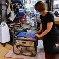 The mother of a 12-year-old boy who uses a ventilator at their home in Daizaifu, Fukuoka Prefecture, bought a generator so that the ventilator won't shut down if a disaster hits. | NISHINIPPON SHIMBUN
